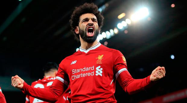 Mohamed Salah celebrates scoring Liverpool's winning goal against Leicester City at Anfield yesterday. Photo: PA Wire