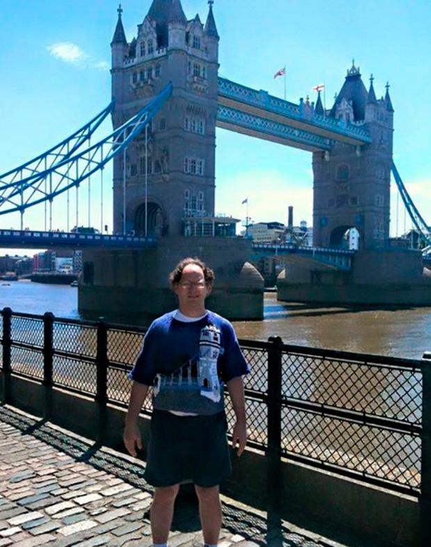 Sam Barsky at Tower Bridge in London wearing a jumper he knitted of the landmark Photo credit: Sam Barsky/PA Wire