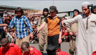 The youngsters prepare to kill the blindfolded men