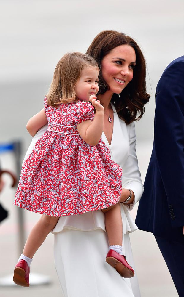 The Duchess of Cambridge and Princess Charlotte arrive at Warsaw's Chopin Airport with The Duke of Cambridge and Prince George for the start of their five-day tour of Poland and Germany. Photo credit : Dominic Lipinski/PA Wire