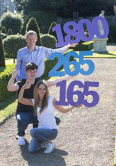Students Jessica Jechiu and Lars Jagar and John Anslow, eir, launching the helpline. Colm Mahady / Fennells