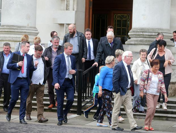 Relatives of those killed by a loyalist gang in the Gleanne area of Armagh in the 1970's pictured at the High Court in Belfast where they won a ruling in their favour about the investigation into the killings.