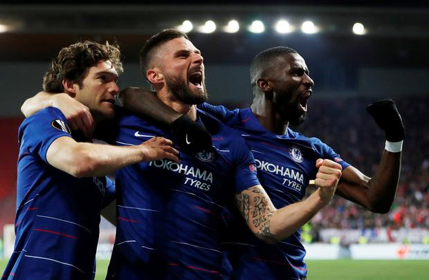 Chelsea's Marcos Alonso celebrates scoring their first goal with Olivier Giroud and Antonio Rudiger