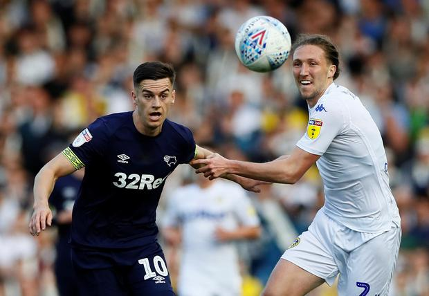Derby County's Tom Lawrence in action with Leeds United's Luke Ayling. Photo: Reuters