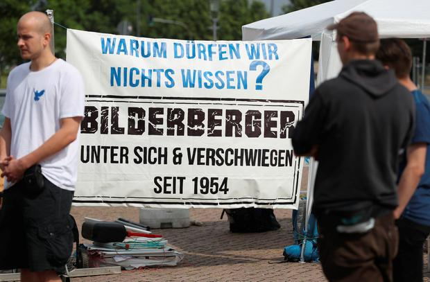"Peace activists with a banner that reads: ""Why aren't we allowed to know? Bilderberger - amongst themselves and silent since 1954"" maintain a vigil near the venue of the 2016 Bilderberg Group conference on June 9, 2016 in Dresden, Germany. (Photo by Sean Gallup/Getty Images)"
