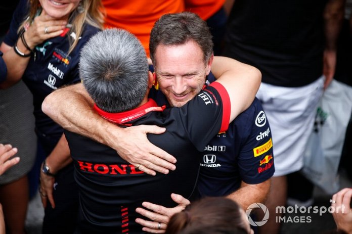 Masashi Yamamoto, General Manager, Honda Motorsport, and Christian Horner, Team Principal, Red Bull Racing, celebrate in Parc Ferme