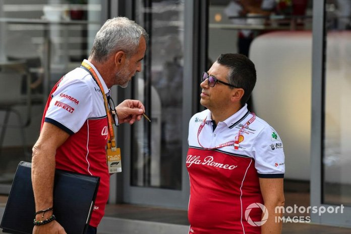 Beat Zehnder, Team Manager, Alfa Romeo Racing, speaks with a colleague