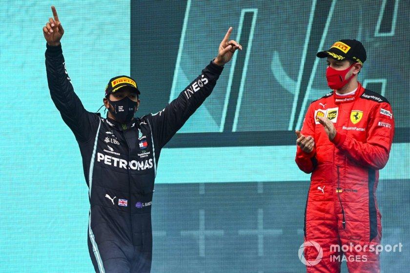 Podium: winner and world champion Lewis Hamilton, Mercedes-AMG F1, and third place Sebastián Vettel, Ferrari