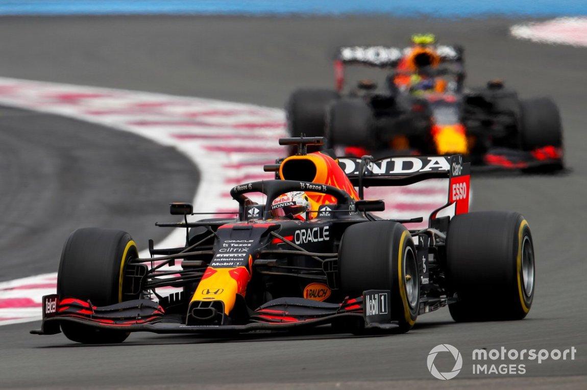 Max Verstappen, Red Bull Racing RB16B, precedes Sergio Perez, Red Bull Racing RB16B