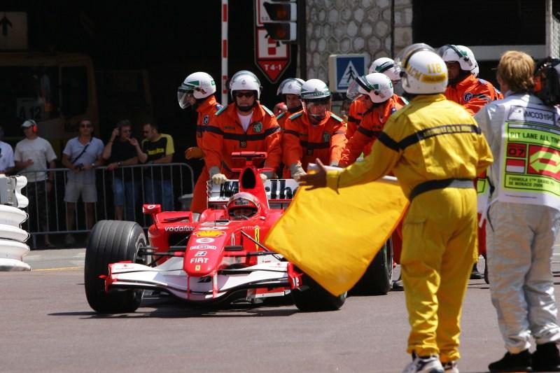 Marshals push the pole position-winning car of Michael Schumacher, Ferrari 248F1, 2006 Monaco GP, F1