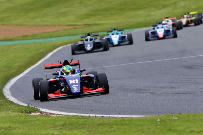 Christian Mansell stormed into the lead at the start of race three