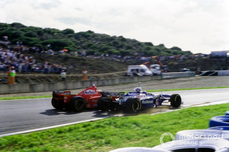 The controversial collision between Michael Schumacher, Ferrari F310B, and Jacques Villeneuve, Williams FW19 Renault. Schumacher was judged to have deliberately turned in on his rival Villeneuve, and subsequently was excluded from the entire championship as a result.