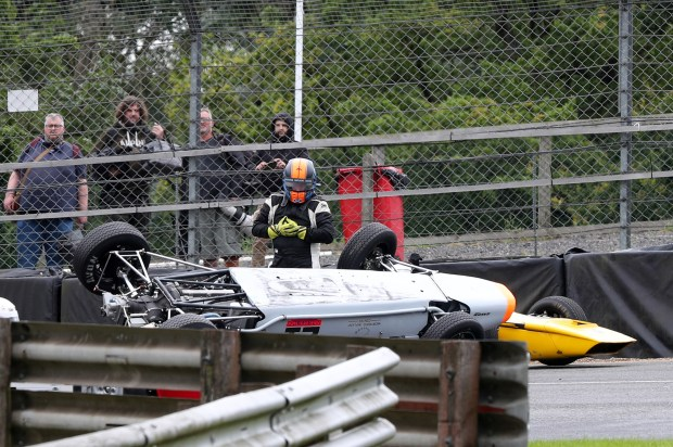 Ross Dryborough's Merlyn flipped at Druids in the Historic Formula Ford race, causing a red flag