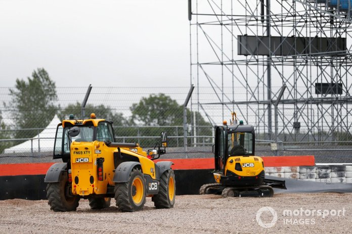 JCB machines are used to work on a barrier