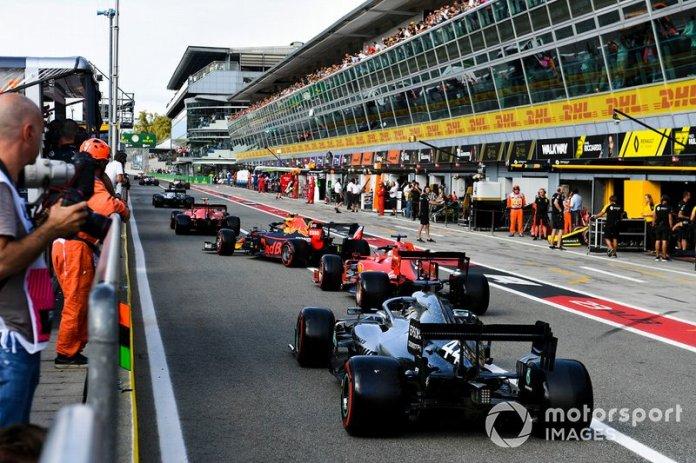 Charles Leclerc, Ferrari SF90, leads Alex Albon, Red Bull RB15, Sebastian Vettel, Ferrari SF90, and Lewis Hamilton, Mercedes AMG F1 W10, out of the pits