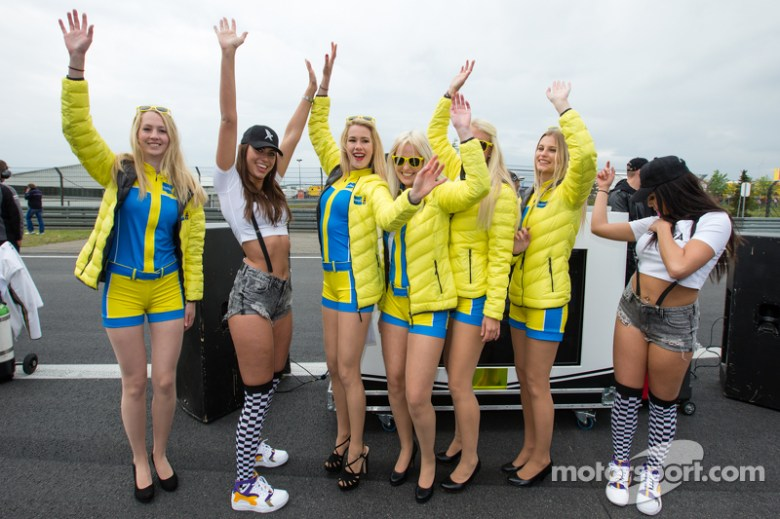 Black Falcon party girls meet the Aston Martin Racing Aston girls on the starting grid at 24 ...