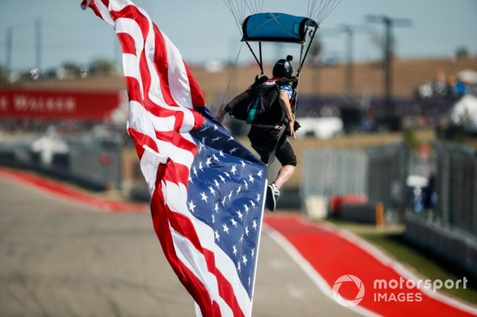 Pre-race airshow, American flag arrives on the starting grid