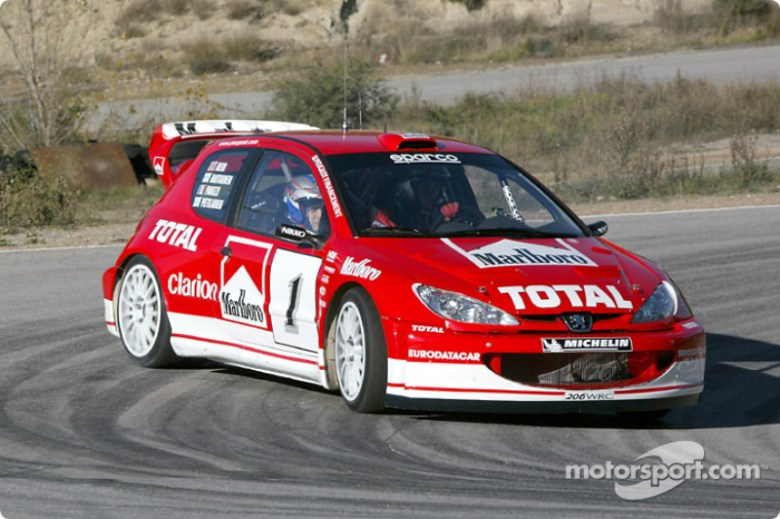 Gilles Panizzi in the new Peugeot 206 WRC 2003 at Peugeot 206 WRC 2003 presentation