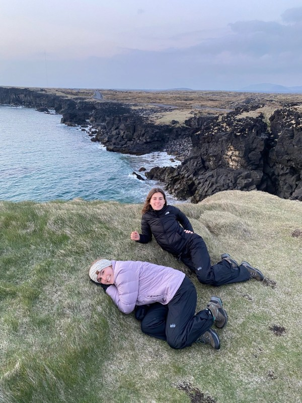 Sisters posing with scenic views of Snæfellsjökull National Park in the background.