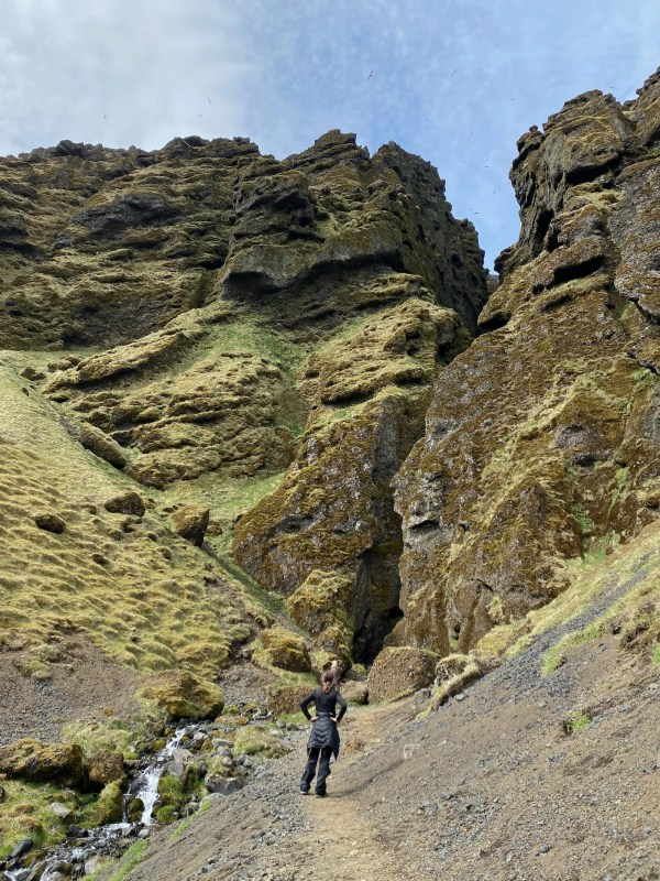 Teen girl in front of canyon on Snæfellsnes Peninsula.
