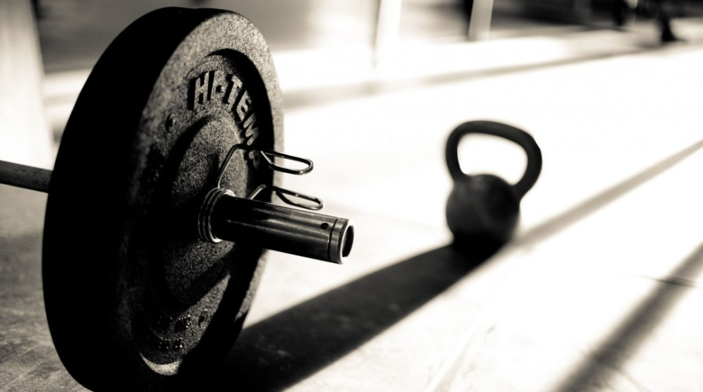 Barbell and Kettle-bell casting a shadow