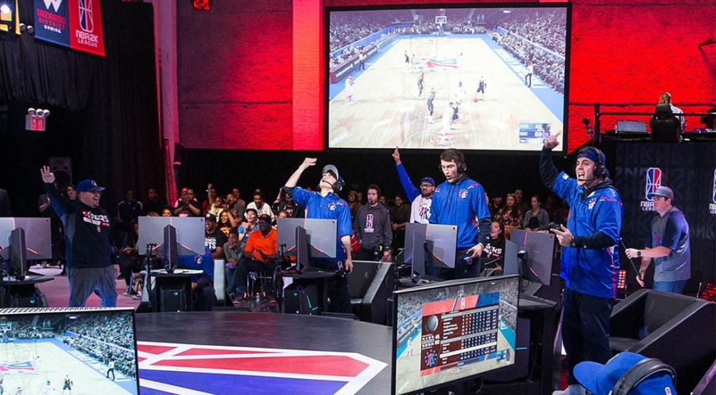 Newdini33, I F E A S T, and Steez of 76ers Gaming Club reacts during game against Magic Gaming on JUNE 22, 2018 at the NBA 2K League Studio Powered by Intel in Long Island City, New York.