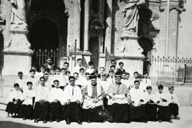 Mgr Zarb with the altar boys of the parish.