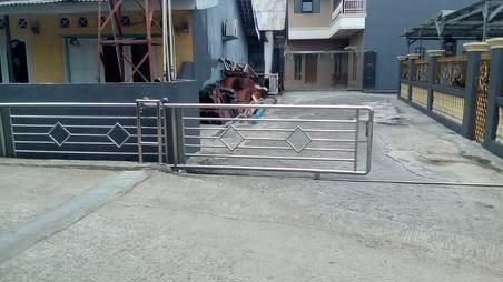 potret lucu pagar rumah © Berbagai sumber