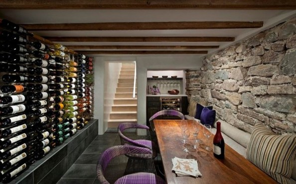 Chairs-add-color-and-informal-charm-to-the-wine-tasting-room-with-stone-walls decoist