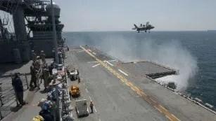 An lands aboard the amphibious assault ship USS Wasp during 2015 trials.