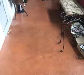 need to tile stained concrete floor