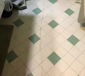 cracked bathroom floor tiles is there