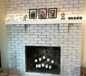 whitewash painted brick fireplace