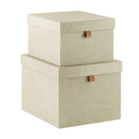 Photo of beige Stackable storage bins from The Container Store.
