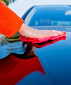 woman-polishing-car-cloth