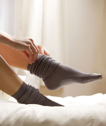 woman-pulling-on-sock