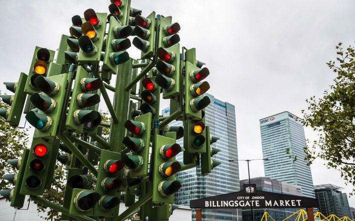 The Traffic Light Tree in London,  England   Not all Christmas trees are glittering, light-filled pines. Some are made of chainsaws or sand. Others are towering collections of skis and tumbleweeds. Read on for the world's strangest Christmas trees.