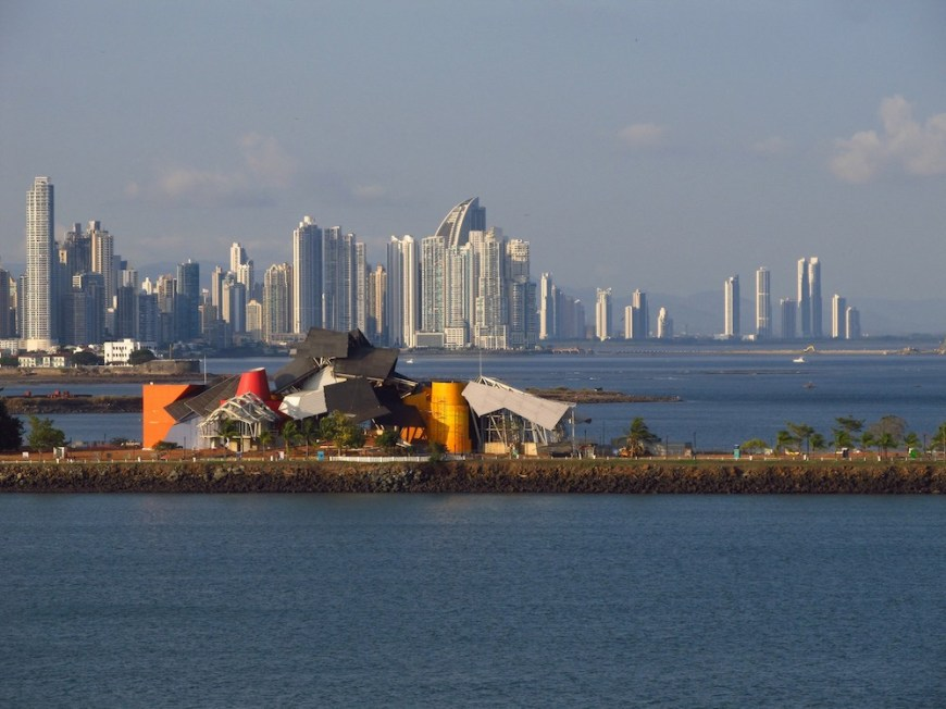 Architecture In Panama Image: Another view of the Gehry building shows us Panama City's architectural skyline, which includes cylinders, and a curved wedge.