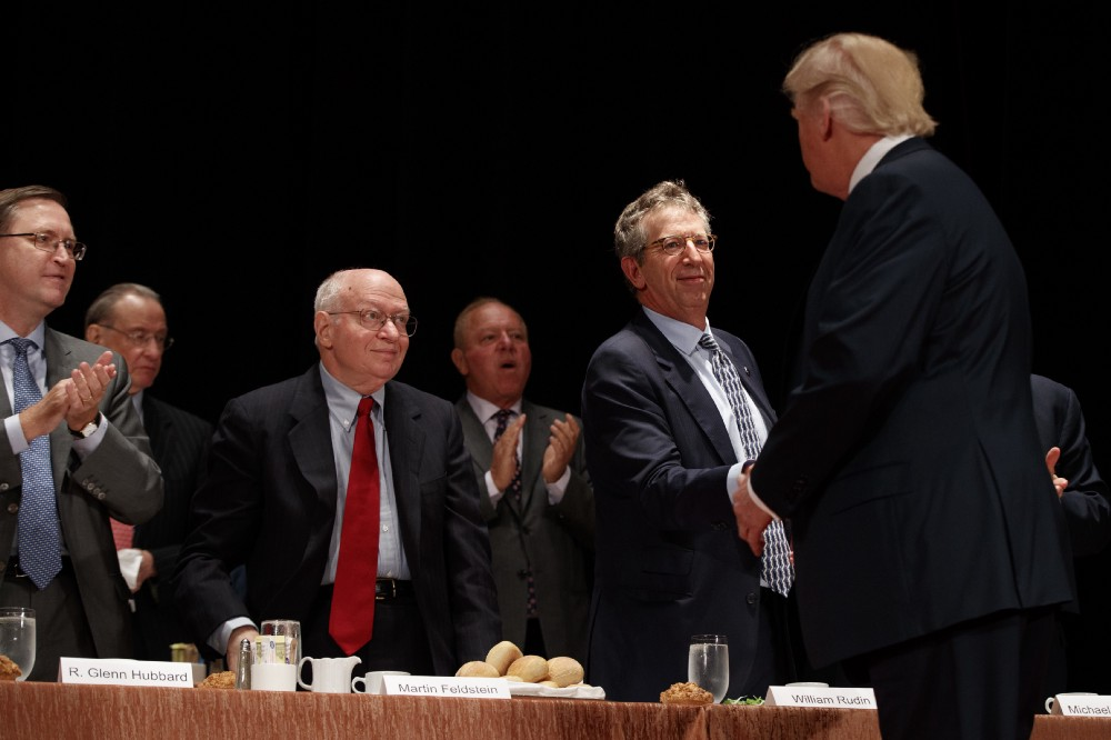 Economists, from left, R. Glenn Hubbard, left, Martin Feldstein, and William Rudin, greet then-Republican presidential candidate Donald Trump as he arrives to speak at the Economic Club of New York, Thursday, Sept. 15, 2016, in New York. (AP Photo/ Evan Vucci)