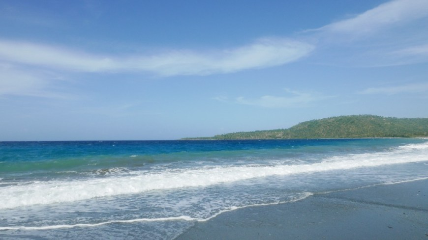 Best Surfing Beaches: A photograph of Cuba's beautiful and calm beach; the waves have yet to break.