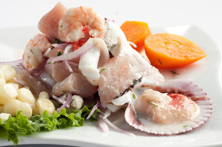 Visit Peru Image: A close-up of beautifully arranged ceviche on a white plate is the perfect start to a Peru food tour.