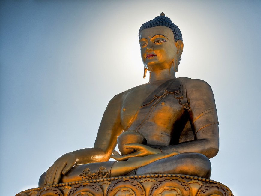 Destinations Worth Dreaming Image: The golden Buddha Dordenma statue has a slight smile, and holds a bowl.