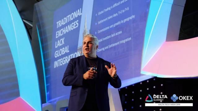 DELTA Summit OKEx Malta Tech Week—Enzo Villani announcing OKEx's SRO initiative at DELTA Summit