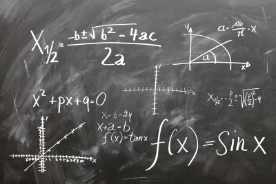 Algebra written on a blackboard.