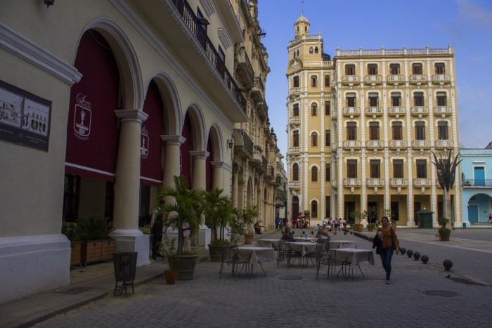 Cuba Unusual Museum Image: We see two pale lemon buildings with white accents and arches—the structures are decidedly traditional, not modern.