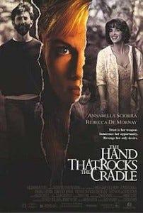 hand rocks the cradle