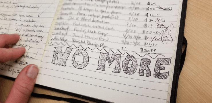 A work journal with the words NO MORE