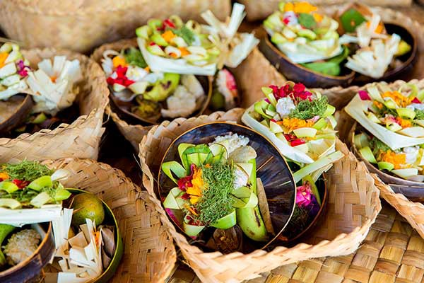 Destinations Worth Dreaming Image: Delicious and colourful meals sit in woven baskets.