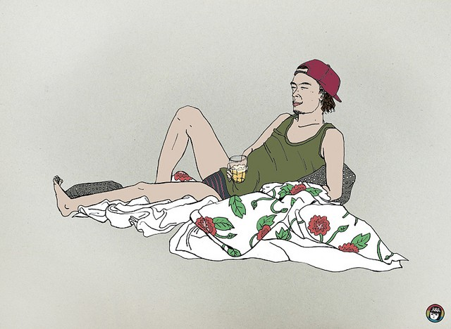 A person with short hair and facial hair lean back against a pillow, holding a drink in one hand. They are relaxing on a floral bed sheet, and wearing a tank top, underwear, and a cap which they have on backwards. Credit: Minjung Gang, via Flickr, CC BY-NC-ND 2.0.