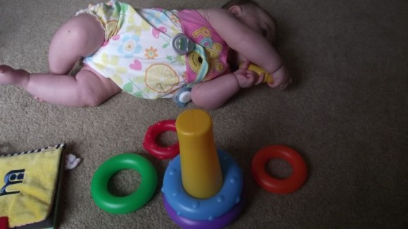 child enjoying the gift of a toy